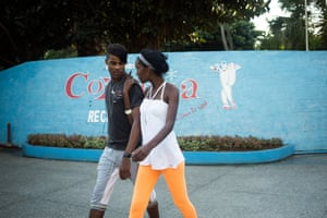 A young couple leaving Coppelia, in the park surrounding the main building.