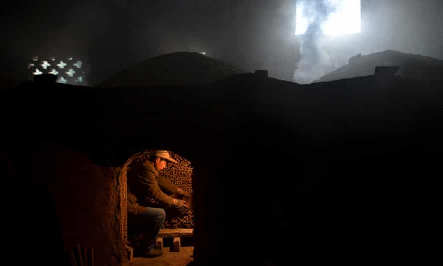 A worker burns bamboo charcoal at a mill at Huoshan county, Anhui province, China.