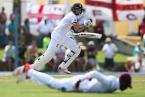 Joe Root plays a shot to the offside boundary as he matches Ian Bell with a half century.
