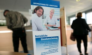 Jobseekers wait to be seen at a jobcentre in Hamburg, Germany