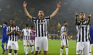 Patrice Evra, left, Leonardo Bonucci, centre, and Arturo Vidal celebrate after beating Borussia Dortmund 3-0 away in the Champions League round of 16.