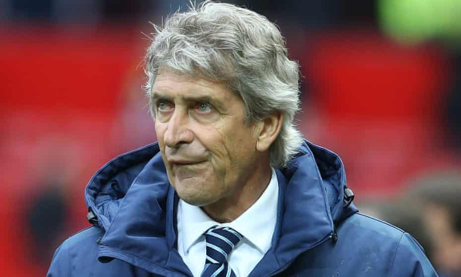 Manchester City manager Manuel Pellegrini walks off after the 4-2 defeat at Manchester United.