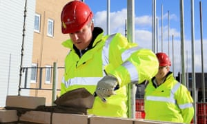 David Cameron laying bricks.