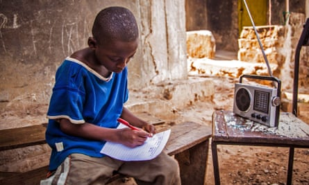 In this photo taken on Thursday, Feb. 26,  2015, a boy listens to school classes broadcast over the radio, due to the Ebola virus outbreak in Sierra Leone schools across the country have been closed in an effort to prevent the spread of the virus in Freetown, Sierra Leone.  According to the head of the national Ebola response Centre, complacent behavior in Sierra Leone has led to a worrying spike in confirmed Ebola cases over the past week in four districts, Alfred Palo Conteh said Thursday, March 12, 2015.