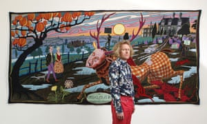 Grayson Perry in front of his The Upper Class at Bay, 2012 .
