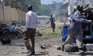 People run from the scene of a car bomb outside the education ministry in Mogadishu.