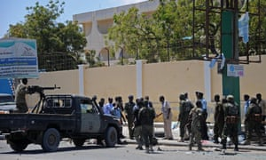 Somali security services gather outside the education ministry in Mogadishu.