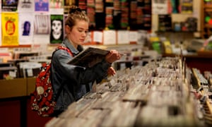 A young woman browses vinyl at Jumbo Records shop in Leeds, in April 2014