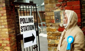 People arrive to cast their votes at a polling station in Tower Hamlets, east London.