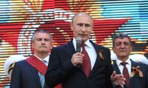 Vladimir Putin addresses a Victory Day parade in Sevastopol