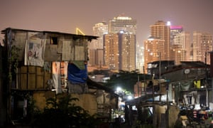 A shanty town and sky scrapers in Manila