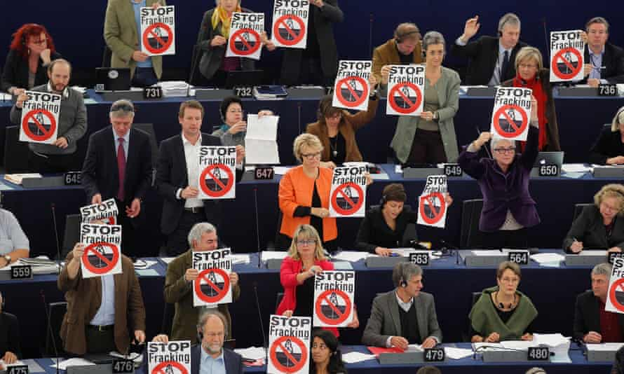 Members of the the Group of the Greens/European Free Alliance of the European Parliament hold leaflets with the slogan Stop Fracking