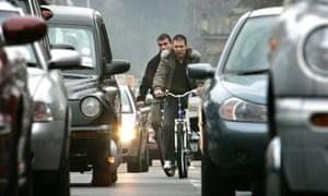 Cycling on Princes Street, Edinburgh.