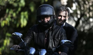 Greek finance minister, Yanis Varoufakis , drives his motorcycle with deputy foreign minister for international economic relations, Euclid Tsakalotos riding pillion.