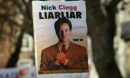 A poster of Nick Clegg is displayed on a placard held by a student demonstrator on 9 December 2010 in London as parliament voted on whether to implement the coalition government's proposals to increase university tuition fees.