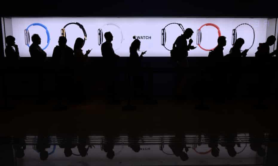 People wait in a queue to test out the new Apple Watch at a store in Hong Kong on April 10, 2015. Apple says its first wearable device will connect wirelessly to a user's iPhone and will be the interface for messaging, calls and apps, especially ones geared toward health and fitness.