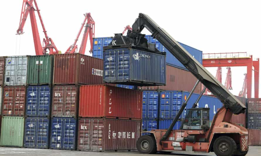 China: a crane moves a container