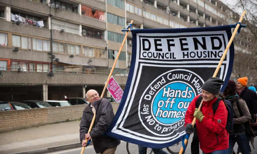 Social housing activists march through the Aylesbury Estate protesting against private investment and a lack of social housing in Southwark, south-east London.