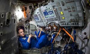 Astronaut Scott Kelly sits inside a Soyuz simulator at the Gagarin Cosmonaut Training Centre