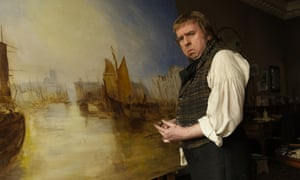 Spall in the title role of Mr Turner, standing in front of a painting