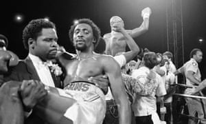 Hearns is carried from the ring as Hagler celebrates.