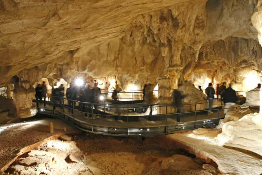 Visitors in the life-size replica of the Chauvet cave, in southern France.