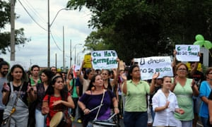 Activists protest in front of the Environment Secretariat in Asuncion on February 13, 2015 against the mining in Cerro  Leon, in the Defensores del Chaco Par