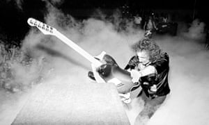 Ritchie Blackmore, guitarist with Deep Purple, smashing guitar against speakers on US tour. 1974