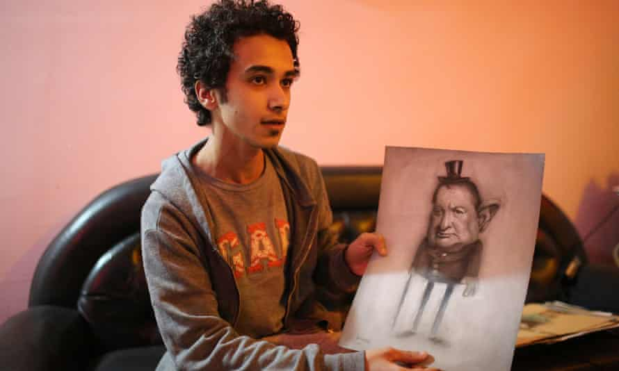Hussein Adel with one of his drawings