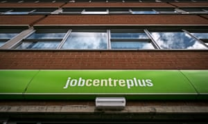 Jobcentre sign, looking up at multi-storey building