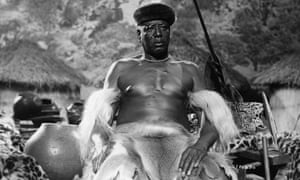 An African tribal chief sits on his throne in a scene from the film Rhodes of Africa