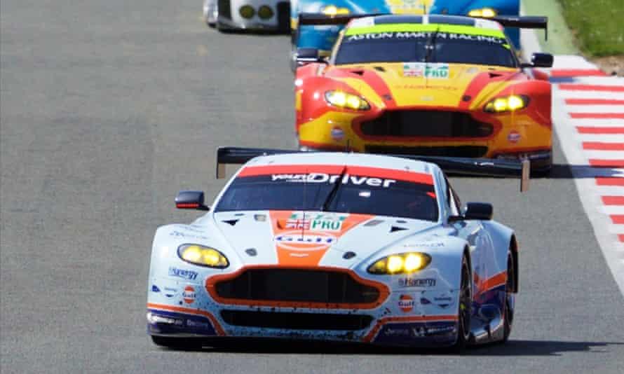 Racing demons: Aston Martins go through their paces.