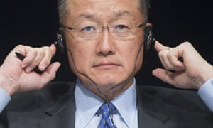 World Bank Group president Jim Yong Kim holds his headphones during the 2015 Global Parliamentary Conference. Kim acknowledges that land privatization threatens the livelihoods of thousands in the developing world, but his bank continues to promote policies that encourage it.