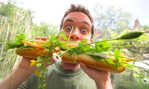Urban gardener eats a bagette stuffed with veg