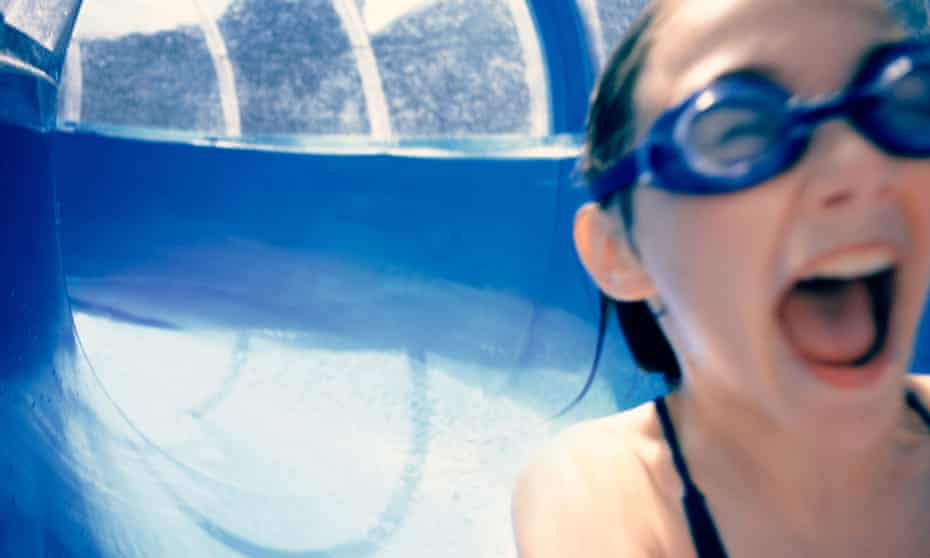 A girl on a water slide at a water park