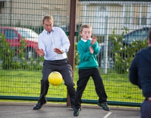 Tim Farron playing football with children at The Adventure playground on the Kirkbarrow estate
