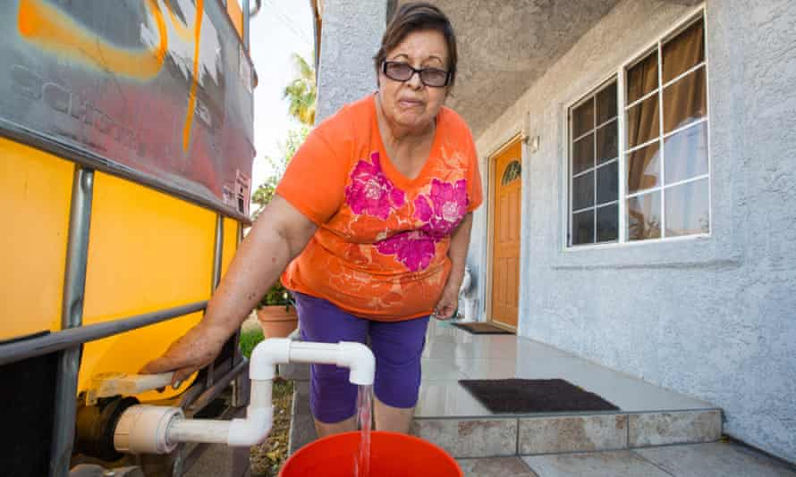A woman at a house in Porterville, California, which had no running water for several months as a result of drought