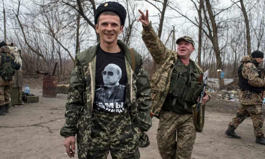 A pro-Russian rebel shows his t-shirt depicting Russian President Vladimir Putin. The songs composed by the separatist fighters are now subject to satirical videos online.