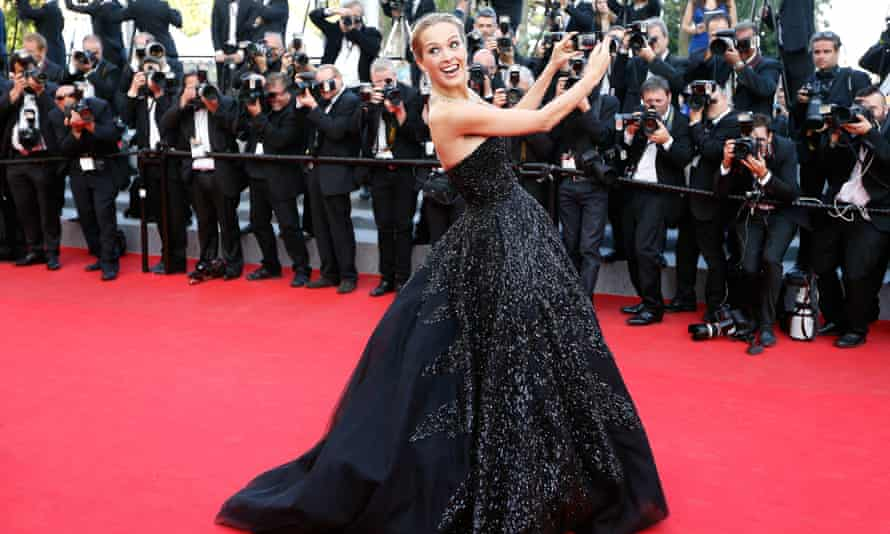 Phone no no ... Czech model Petra Nemcova poses for a selfie on the Cannes red carpet