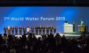 Leaders prepare to pull a rope connected to a 'water clock' as they attend the opening ceremony of the 7th World Water Forum in Daegu.