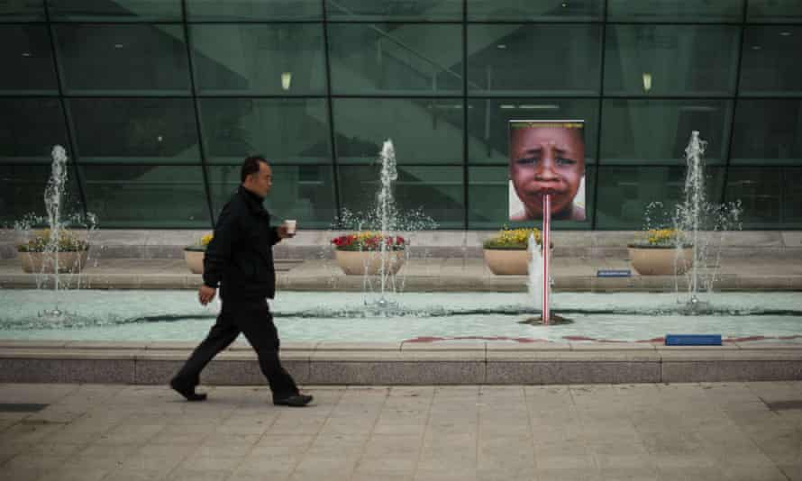 A man walks past a display outside the venue of the seventh World Water Forum in Daegu on April 13, 2011. Held every three years the World Water Forum aims to bring together political leaders, business people and activists to discuss water-related issues across16 themes, including climate change, natural disasters, and energy, and runs until April 17.
