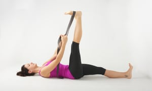 A hamstring stretch with a yoga band