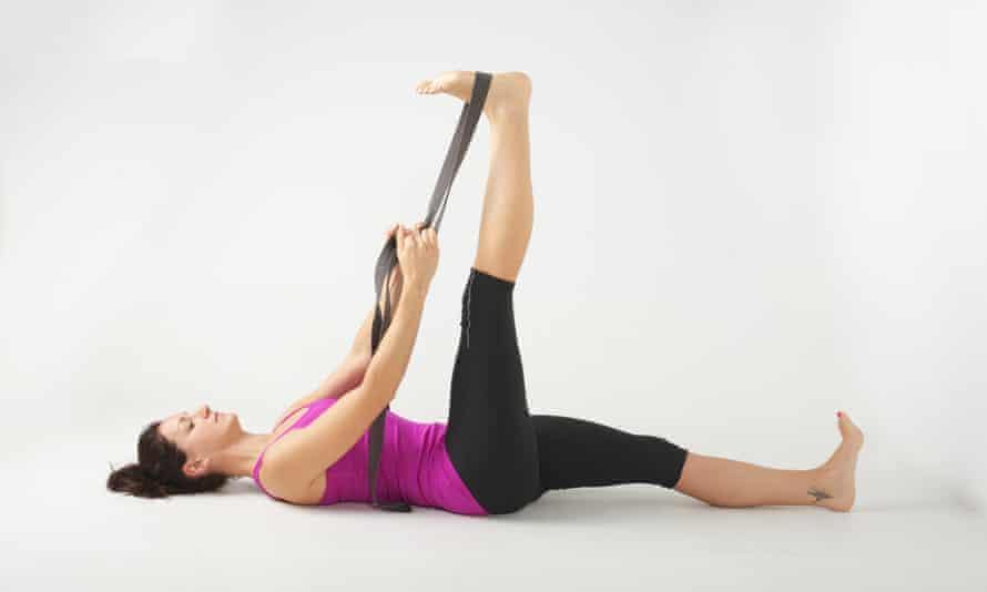 A hamstring stretch with a yoga band