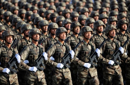 Soldiers from Chinese People's Liberation army march in formation during a training session.