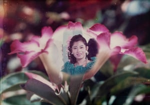 The Company of Flowers, 1991   Combination Printing of a portrait and a photograph of flowers. This style of photography is still very popular in Cambodia