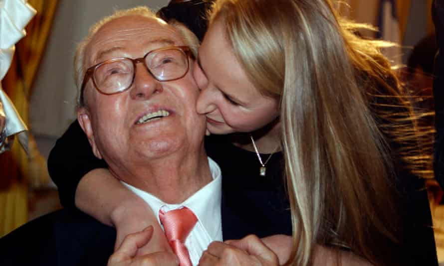 Jean-Marie Le Pen is kissed by his granddaughter Marion.