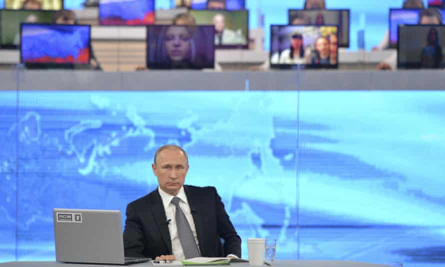 The Russian president, Vladimir Putin, takes part in a live call-in in Moscow.