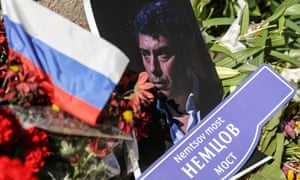 A photograph and floral tributes at the site of Boris Nemtsov's murder in central Moscow.