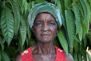 Amai Kauswe standing in her food forest