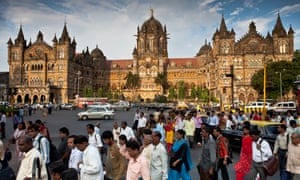 Commuters pour out of Chhatrapati Shivaji Terminus, at the southern end of Mumbai.